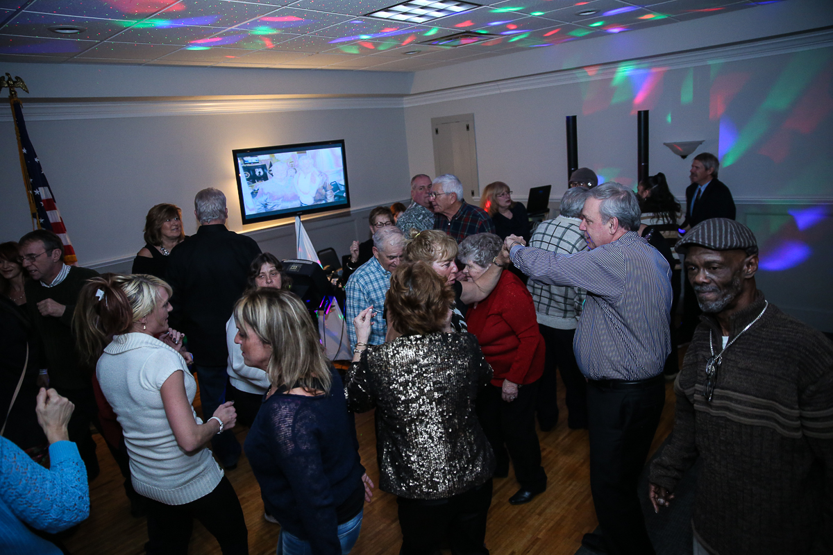Photo By Curtis Knight.  A packed dance floor at the Lynnway auto Auction  Holiday Party 01-17-15.