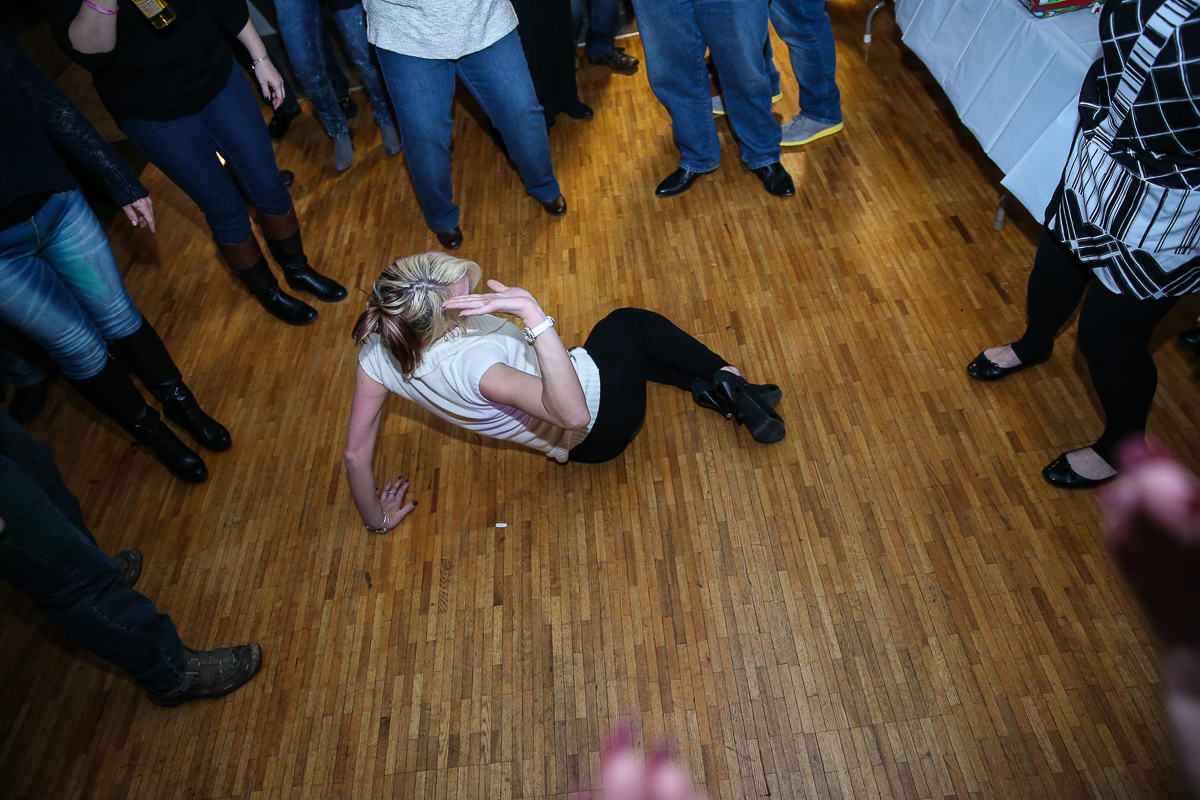 Photo By Curtis Knight.  A packed dance floor with break dancing at the Lynnway auto Auction  Holiday Party 01-17-15.