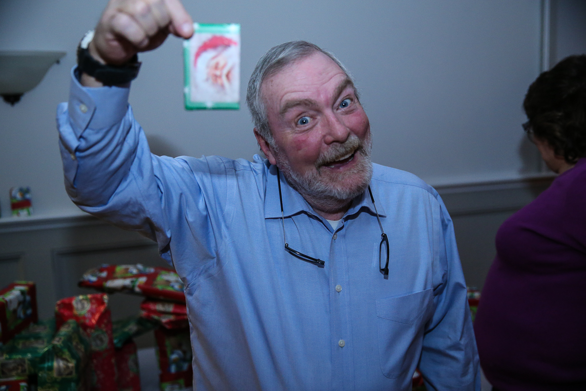 Photo By Curtis Knight.  Man holds up present he won at the Lynnway auto Auction  Holiday Party 01-17-15.