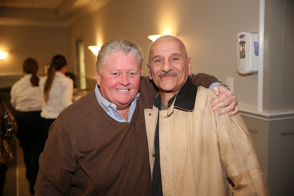 Photo By Curtis Knight.  Jim hugs Frankie at the Lynnway auto Auction  Holiday Party.